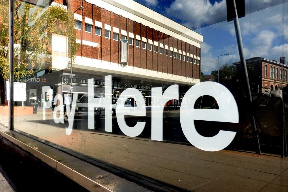 Pay here sign 1000x667