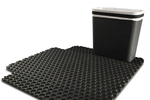 The Carbage trash container is designed to clamp onto floor mats to avoid tipping en route.