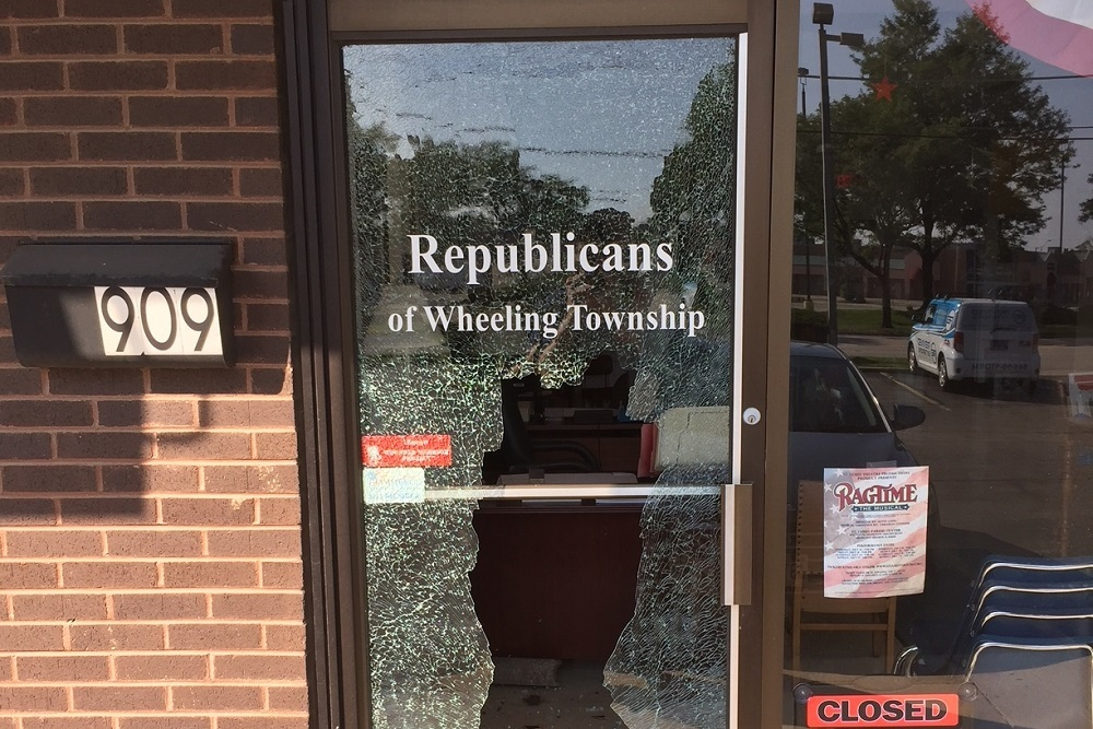 Large rectangular hole in the front door of Wheeling Township Republicans headquarters in Arlington Heights.