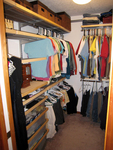 Keeping clothes organized in sections helps keep any closet more manageable.
