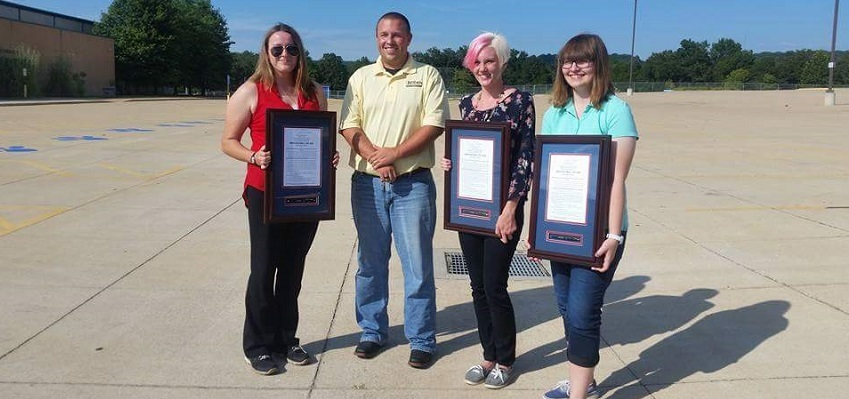 Northwest High School students Claire Hughes, Molly Stuckmeyer and Hannah Nashfrom with Missouri Rep. Shane Roden.