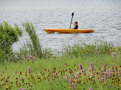 Water sports, like kayaking in Brushy Creek Lake Park, are one of the many attractions in Cedar Park.
