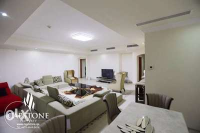 Living space in a three bedroom apartment available in Porto Arabia.