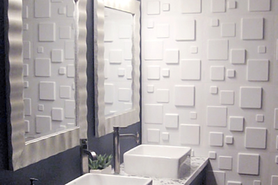 A textured accent wall in a small bathroom can do a lot for aesthetics.