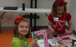 Children from local organization enjoy activities with U of A students.