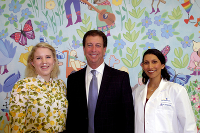 (Left to right) Kate Peoples, Nyle Maxwell and Dr. Sonia Krishna celebrate the $3 million challenge grant for a mental health unit at Dell Children's Medical Center.