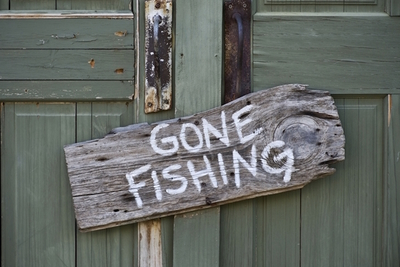 Medium gone fishing sign