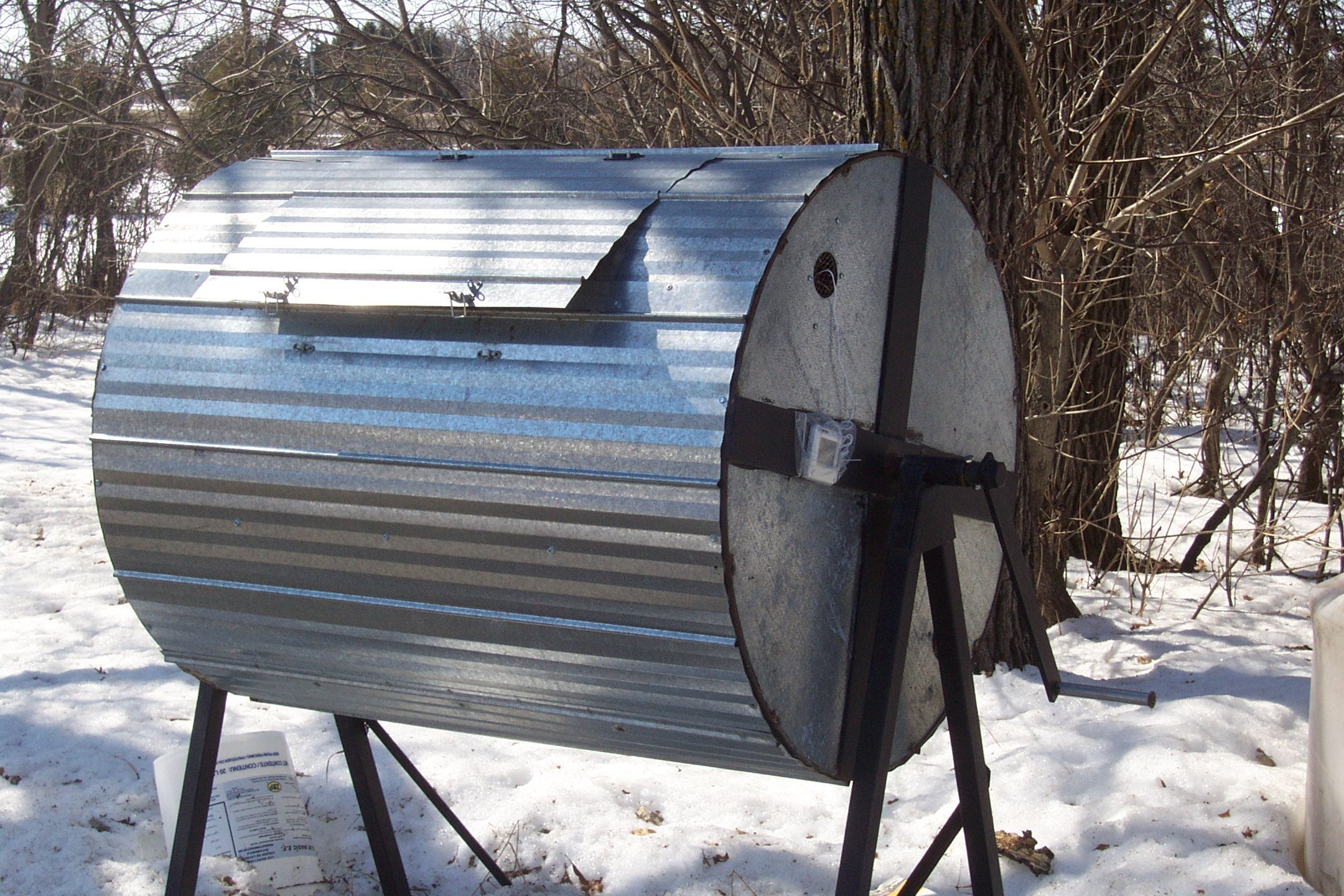 A compost barrel which can be rotated allows for easy mixing.