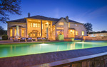 With an inviting pool and palatial outdoor living, this home on nearly 6 acres is perfect for entertaining.