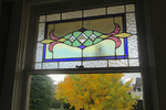 Stained glass windows often find their way onto the exterior of residential homes.