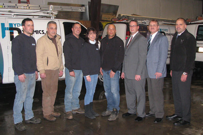 NEPA and Hydrodynamics officials gathered recently for a ceremony at which Hydrodynamics received a $56,000 small-business loan.