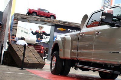 Under the gaze of Big Tex, crews scramble to get the annual auto show ready for the State Fair in Dallas.