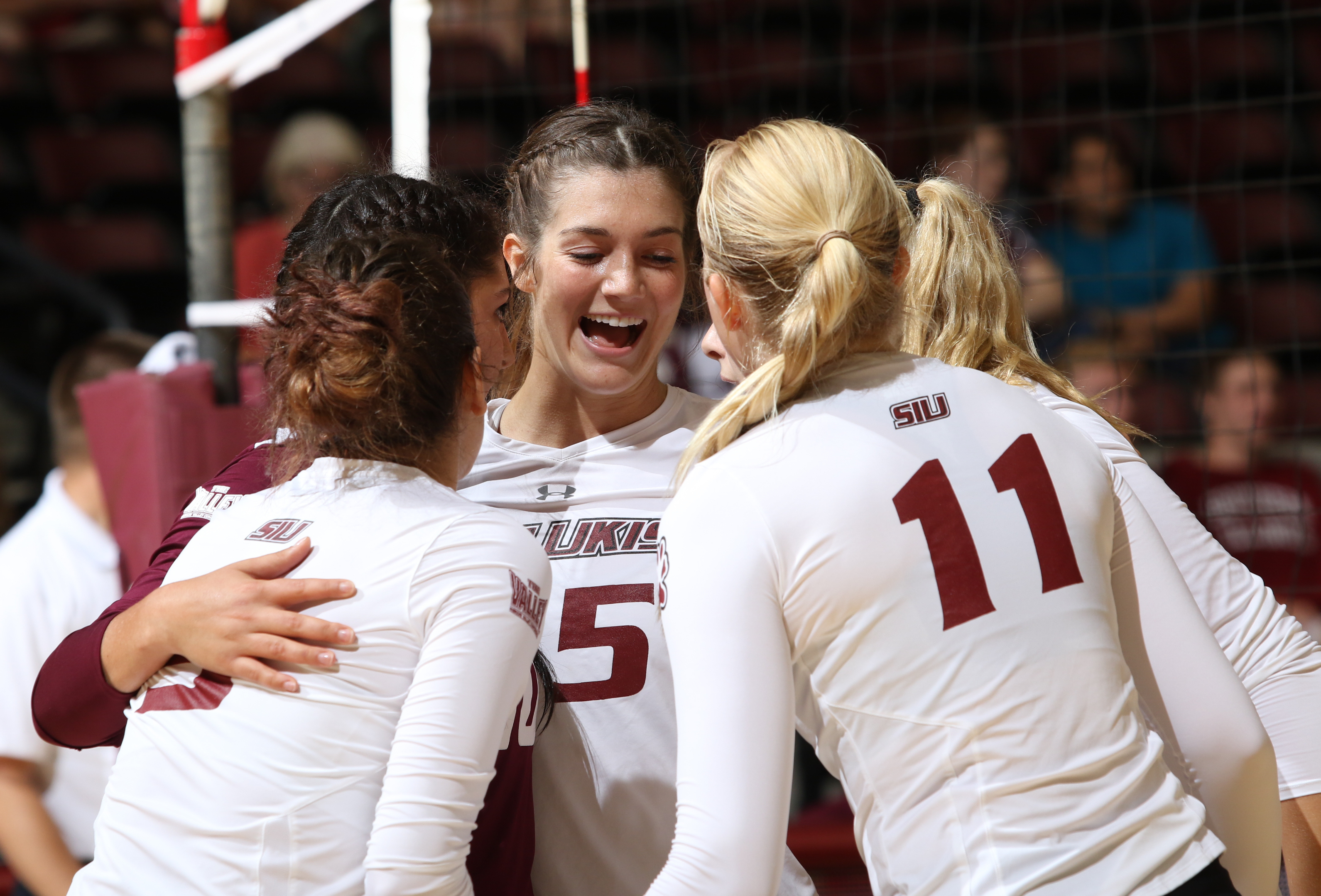 SIU's volleyball team celebrates a point.