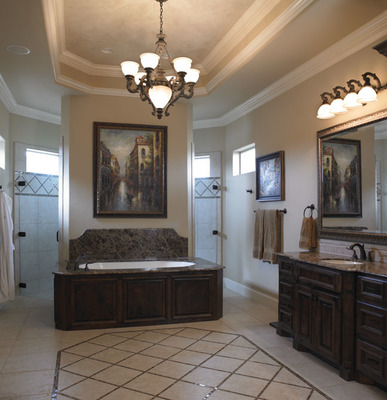 A chandelier and open plan gives the feeling of luxury in the bathroom.