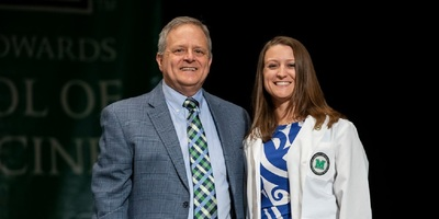 Erin Shaver's father Mitch, a Huntington physician, presented her with her white coat.