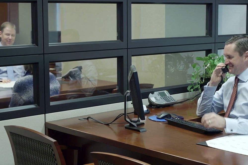 Signature bank co-founder Kevin Bastuga, right, and co-founder Bryan Duncan are videotaped while working at the Signature Bank branch in a promotion video posted on their website.