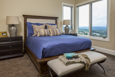 Ready-made affordable bedding costs less than ordering custom bedding and still provides a great look for this guest bedroom.