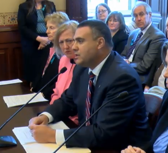 Rep. Michael Unes (R-Pekin) presents pediatric sexual abuse legislation at the April 10 House Human Services Committee hearing