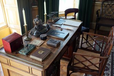 A quality antique desk makes an elegant centerpiece for an office.