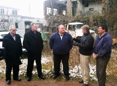 Standing in front of the former Kaier's Brewery, state and local officials outline the plans for demolition and remediation of the Mahanoy City property.