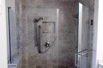 Custom showers have replaced large soak tubs as the must-have bathroom luxury.