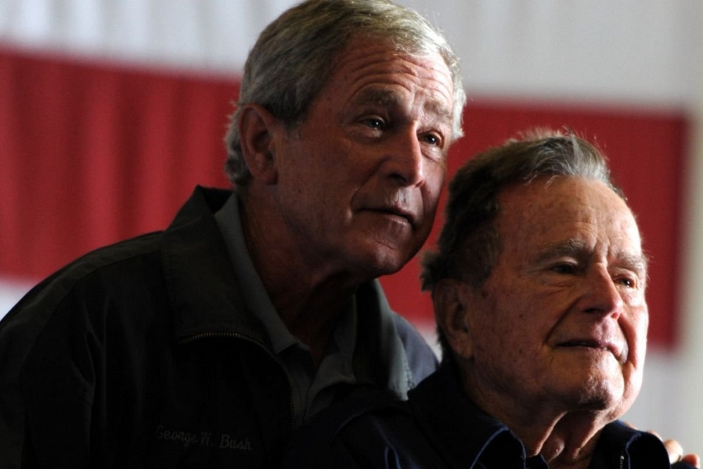 Former President George W. Bush, left, with his father, George H.W. Bush, in a 2017 White House photo