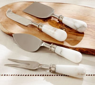 Marble cheese knives, four in the set.