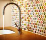 This bottle-cap backsplash was designed by Natalie Howe Design.