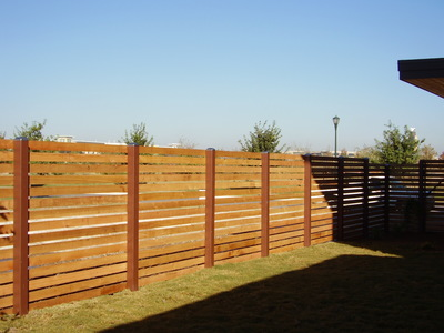 Horizontal fencing is one of the latest trends in wood fencing.