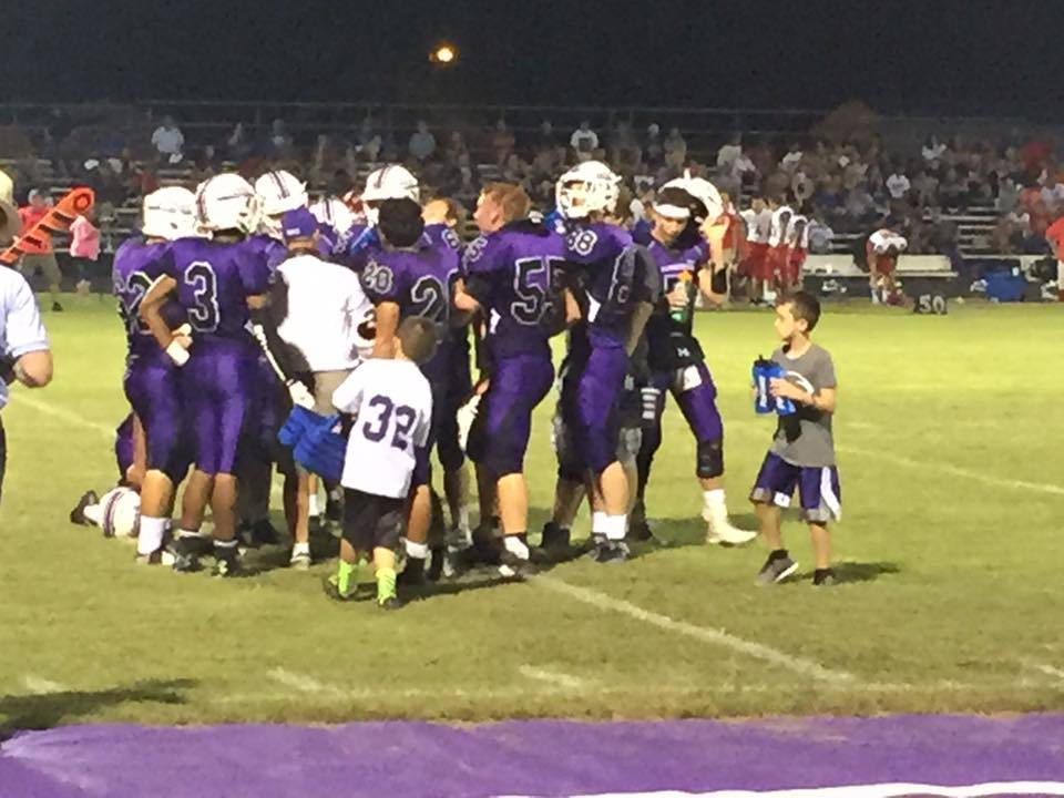 The Harrisburg Bulldogs talk things over during a game last season.