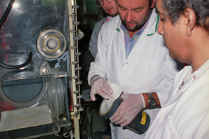 IAEA inspectors take samples from a nuclear facility to perform safeguard analysis.
