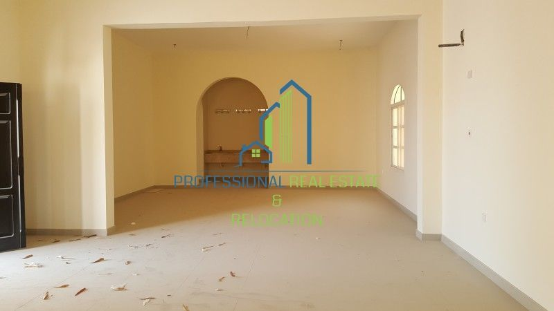 Living space in the five bedroom six bathroom villa available in Al Dafna