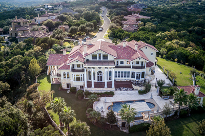 This magnificent estate sits on 2 acres of gorgeous property.