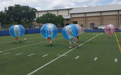 Au pairs from around the world recently took part in a fun game of bubble soccer in West Lake Hills.