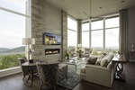 Oversized windows give residents views of the stunning surroundings.