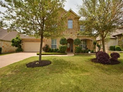 This stunning estate is located in an exclusive gated community.