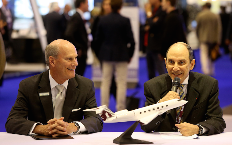 Qatar Airways Group Chief Executive Akbar Al Baker, right, and Gulfstream President Larry Flynn
