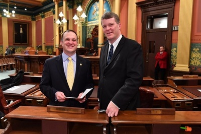 Rep. Matt Hall (left) and Richard Lindsey, executive director of Legal and Community Affairs at Oaklawn Hospital, at Gov. Gretchen Whitmer's first annual State of the State address in February 2019.