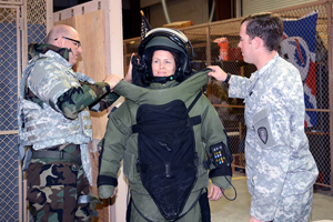 ECBC Scientist, Jennifer Sekowski is fitted with a protective suit against explosives.