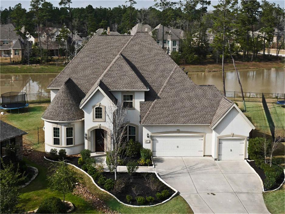 This spectacular waterfront home is located in The Woodlands Creekside Park subdivision.