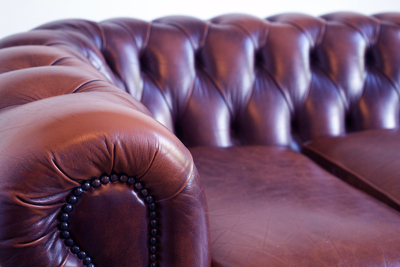 Leather remains one of the most sought-after material choices for couches and chairs.
