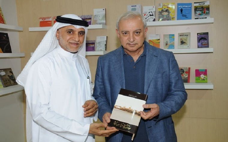 Fadel Hussien, deputy director of libraries in Eastern Zone at SBA, left, and Dr. Badr Al Issa, Kuwaiti minister of education and higher education.