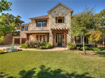 Situated on a meticulously landscaped lot, this stone two-story is full of upgrades.