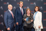 Susan Moffitt holds her 2020 Dealer of the Year award with (from left) NADA President Peter Welch, Ally Auto Finance President Doug Timmerman and Susanna Schrobsdorff, executive editor and chief partnerships officer of Time.