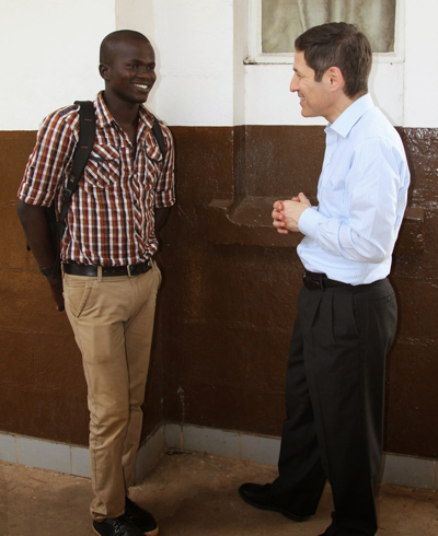 Dr. Tom Frieden, right, speaks with Yusif Koroma, an Ebola survivor who is now caring for orphans at a nearby social services center in Sierra Leone.