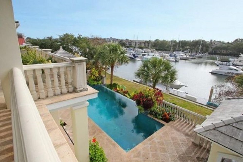 The property at 40 Waterway Island Drive has a private dock, a pool and mature landscaping.