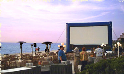 An inflatable outdoor movie screen is a great addition to a party.