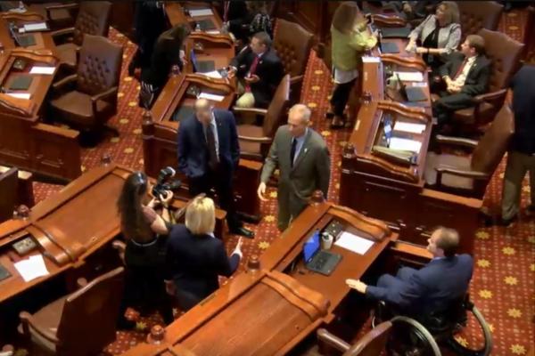 Gov. Bruce Rauner walks on the Senate floor after passage of SB1947.