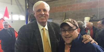 In a file photo, Gov. Jim Justice (left) poses with Wood County Republican Executive Committee Chairman Rob Cornelius.