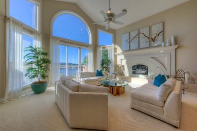 This prestigious custom estate has three very large living areas.